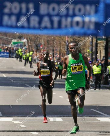 Geoffrey Mutai, Moses Mosop Winner Geoffrey Mutai of Kenya strides ahead of second-place finisher Moses Mosop, also of Kenya, as they approach the finish line of the 115th Boston Marathon in Boston