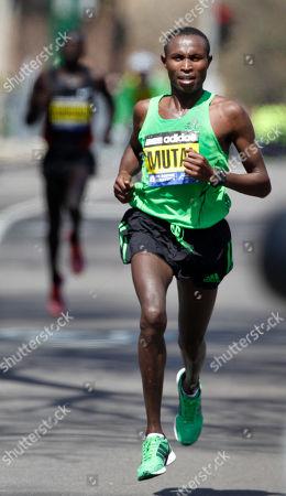 Moses Mosop, Geoffrey Mutai Geoffrey Mutai, right, runs ahead of Moses Mosop, left, both of Kenya, in the final miles of the Boston Marathon, in Boston, Mutai went on to win the race