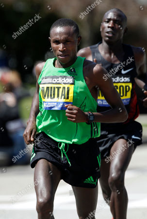 Geoffrey Mutai, Moses Mosop Geoffrey Mutai, left, runs ahead of Moses Mosop, right, both of Kenya, in the Newton, Mass., section of the Boston Marathon, Mutai went on to win the race