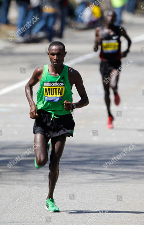 Stock Image of Geoffrey Mutai, Moses Mosop Geoffrey Mutai, of Kenya, left, runs ahead of Moses Mosop, in the Newton, Mass., section of the Boston Marathon, . Mutai went on to win the race
