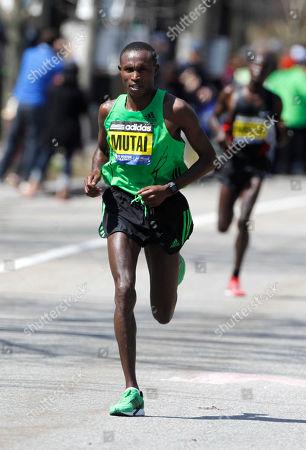 Geoffrey Mutai, Moses Mosop Geoffrey Mutai, of Kenya, left, runs ahead of Moses Mosop, in the Newton, Mass., section of the Boston Marathon, . Mutai went on to win the race