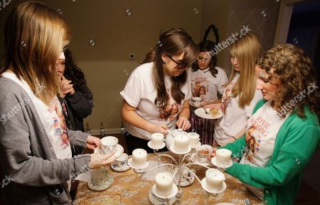 """Stock Photo of Jen Barnette, middle, pours English Tea during a private party in indianapolis, before the start of Britain's Prince William and Kate Middleton wedding ceremony. Some 2 billion people across the globe were expected to tune in as the future king and queen of England start their lives as husband and wife with the two simple words """"I will"""