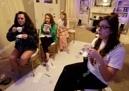 """Jen Barnette right, along with friends watch in indianapolis, the wedding of Britain's Prince William and Kate Middleton. Some 2 billion people across the globe were expected to tune in as the future king and queen of England start their lives as husband and wife with the two simple words """"I will"""