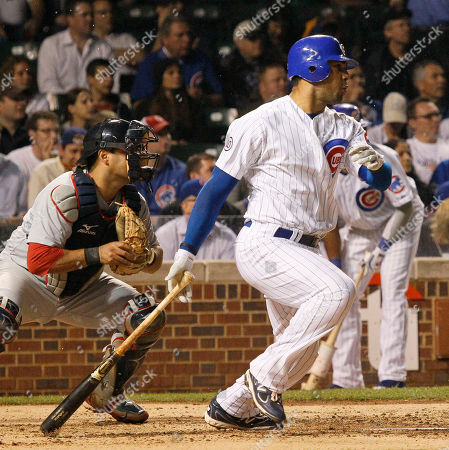 Gerald Laird, Carlos Pena Chicago Cubs' Carlos Pena watches his two-run double off St. Louis Cardinals pitcher Jake Westbrook, scoring Darwin Barney and Marlon Byrd, during the third inning of a baseball game in Chicago. Watching the play is catcher Gerald Laird