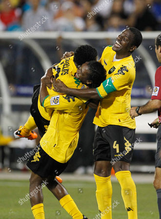 Stock Photo of Demar Phillips, Dne Richards, Jason Morrison Jamaica players, from left, Demar Phillips, Jason Morrison and Dane Richards celebrate Phillips' goal in the second half of a CONCACAF Gold Cup soccer match, in Miami. Jamaica won 2-0