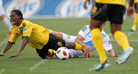 Jason Morrison, Manuel Leon Jamaica's Jason Morrison, left, reacts after colliding with Guatemala's Manuel Leon in the first half of a CONCACAF Gold Cup soccer match, in Miami