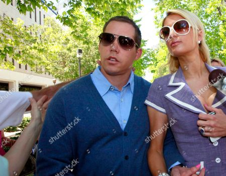 Cy Waits, Paris Hilton An unidentified assailant's arm at left reaching out to grab Cy Waits, left, as he and then-girlfriend Paris Hilton arrive at court in Los Angeles. Hilton and her then-boyfriend Waits were accosted by James Rainford while they walked in to a courthouse to testify against another man who had broken in to the hotel heiress' Hollywood Hills home. Hilton's security wrestled Rainford to the ground and he was promptly arrested him and he pleaded no contest to misdemeanor battery. Rainford, who was repeatedly arrested outside Hilton's residences and asked her to marry him, was ultimately charged with felony stalking and sentenced to probation and psychiatric counseling in April 2012