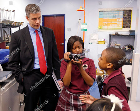 Stock Photo of Arne Duncan U.S. Department of Education Secretary Arne Duncan is questioned by student Trebor Goodall, right, as he's video taped by fellow student Faith Brown during tour the Charles A. Tindley Accelerated School in Indianapolis, . He and Indiana Mitch Daniels held a town hall style discussion with students following the tour