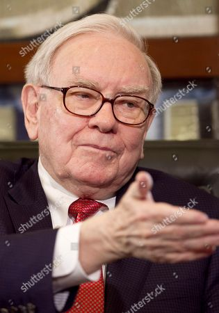 "Warren Buffett Warren Buffett, Chairman and CEO of Berkshire Hathaway gestures during an interview, in Omaha, Neb. Buffett is bringing his fight to raise taxes on the super-wealthy to Congress' deficit-reduction supercommittee. In an exchange of letters between the billionaire investor and Rep. Tim Huelskamp, R-Kan., that Buffett sent the committee this week, Buffett is offering to release his federal tax returns, with a condition. ""If you could get other ultra rich Americans to publish their returns along with mine, that would be very useful to the tax dialogue and intelligent reform,"" Buffett wrote"