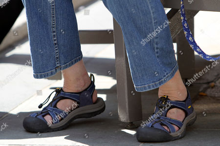 A woman wears a pair of hiking shoes in New York. Shoe designer Alejandro Ingelmo recently spent a morning in Midtown with the Associated Press, conducting a reality check of what people are wearing: As predicted, he found too many toning sneakers and not enough stilettos