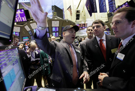 Rich Beyer, Evan Solomon, Gnlen Carrell Rich Beyer, second from right, Chairman and CEO of Freescale Semiconductor, meets with specialists Evan Solomon, left, and Glenn Carrell, right, before his company's IPO begins trading on the floor of the New York Stock Exchange