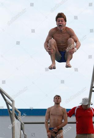 Oleksandr Bondar, Matthew Mitcham Oleksandr Bondar, of Ukraine, dives as Matthew Mitcham, of Australia, rear center, looks on during a men's platform semifinal round at the USA Diving Grand Prix, in Fort Lauderdale, Fla