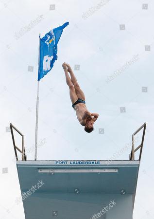 Matthew Mitcham Matthew Mitcham of Australia, competes during a men's platform semifinal round at the USA Diving Grand Prix, in Fort Lauderdale, Fla