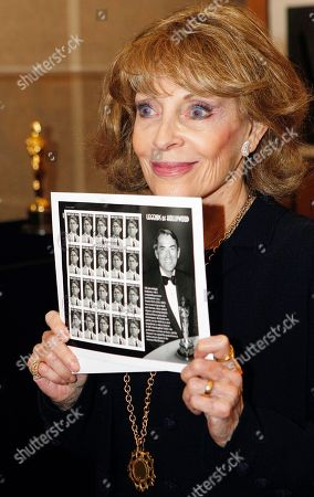 "Stock Photo of Veronique Peck Veronique Peck, the wife of Gregory Peck shows the newly released U.S. Postal Service Forever stamps with her husband, Gregory Peck at the Academy of Motion Picture Arts and Sciences in Beverly Hills, Calif., . It features Peck as Atticus Finch in the classic 1962 film: ""To Kill a Mockingbird"