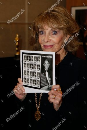 "Veronique Peck Veronique Peck, the widow of Gregory Peck shows the newly released U.S. Postal Service Forever stamps with her husband, Gregory Peck at the Academy of Motion Picture Arts and Sciences in Beverly Hills, Calif., . It features Peck as Atticus Finch in the classic 1962 film: ""To Kill a Mockingbird"