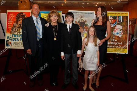 The family of actor Gregory Peck arrives for a U.S. Postal Service first-day-of-issue dedication ceremony for the Gregory Peck forever stamp at the Academy of Motion Picture Arts and Sciences in Beverly Hills, Calif., . From left: Anthony Peck, son, Veronique Peck, widow of Peck, and Cecilia Peck, daughter of Peck with children: Cecilia and son Carey