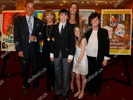 The family of actor Gregory Peck arrives for a U.S. Postal Service first-day-of-issue dedication ceremony for the Gregory Peck forever stamp at the Academy of Motion Picture Arts and Sciences in Beverly Hills, Calif., . From left: Anthony Peck, son, Veronique Peck, widow of Peck, and Cecilia Peck, daughter of Peck with her children: Cecilia and son Carey