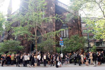 Mourners leave the memorial sevice for photographer Tim Hetherington at First Presbyterian Church, in New York