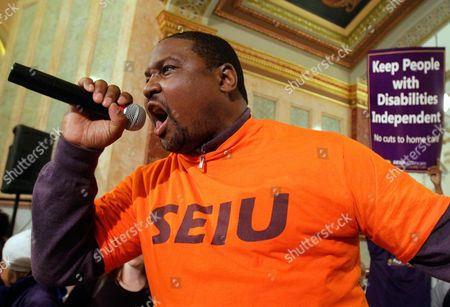 Dale Jackson of Chicago, and other Service Employees International Union members rally in hopes of getting state officials to reverse course on proposed budget cuts at the Illinois State Capitol in Springfield, Ill
