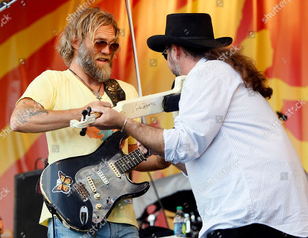 Stock Picture of Anders Osborne, Waylon Thibodeaux Anders Osborne, left, and Waylon Thibodeaux perform with the Voice of the Wetlands All Stars at the New Orleans Jazz and Heritage Festival in New Orleans