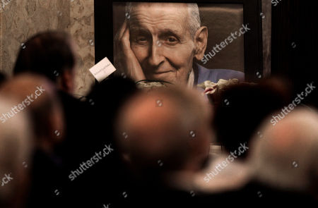 """Dr. Jack Kevorkian A photograph of Dr. Jack Kevorkian is shown at his public memorial in Troy, Mich., . Friends, family and supporters of the late Kevorkian have paid tribute to the polarizing assisted-suicide advocate during a public memorial service in suburban Detroit. Kevorkian will be laid to rest later Friday during a private grave-site service for those closest to him. He died in a hospital last week at age 83. Kevorkian was an advocate of allowing health care professionals help gravely-ill people die and he claimed he assisted in about 130 deaths. He spent eight years in prison for second-degree murder after """"60 Minutes"""" broadcast video of him helping someone die in 1998"""