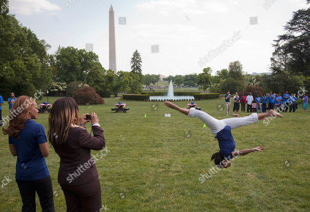 Dominique Dawes Former Olympic gymnast Dominique Dawes does a backflip on the South Lawn of the White House in Washington, during an event with first lady Michelle Obama to promote physical fitness among military families