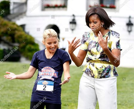 Michelle Obama, Kelly Ripa First lady Michelle Obama and talk show host Kelly Ripa, left, gesture as they talk to young runners participating in LIVE with Regis and Kelly's Run Across America with Dean Karnazes at the South Lawn of the White House in Washington