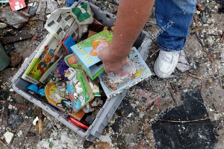 Kenneth Thomas searches through toys kept at his house for his grand children in what used to be his living room, in Joplin, Mo. Thomas' house and much of Joplin was destroyed after a massive tornado hit the area Sunday night