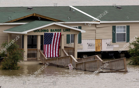 Floodwaters surround Golding Barge Line offices Vicksburg