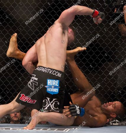 Stock Photo of Jorge Santiago, Brian Stann Brian Stann, left, throws a series of punches down on Jorge Santiago during the first round of a mixed martial arts middleweight bout at UFC 130, in Las Vegas