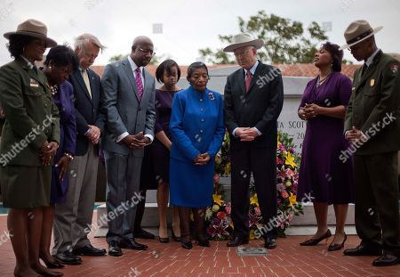 Ken Salazar, Christine King Farris, Rev. Bernice King Secretary of the Interior Ken Salazar, center right, observes a moment of prayer with Christine King Farris, left, and Rev. Bernice King, right, the sister and daughter of Dr. Martin Luther King Jr., and others at his crypt before a ceremony to mark the restoration of the sanctuary of the historic Ebenezer Baptist Church where Dr. King preached in Atlanta
