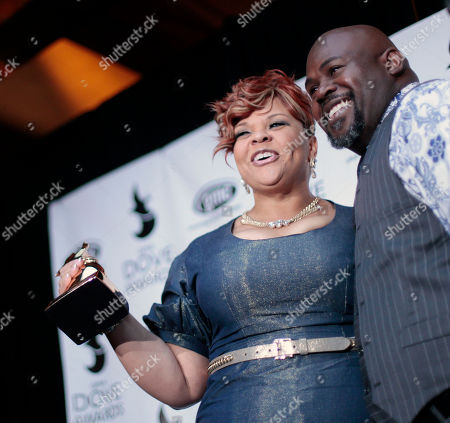 Singer and actress Tamela Mann holds her award after winning Traditional Gospel Album with her husband David Mann at the 42nd annual Dove Awards, in Atlanta