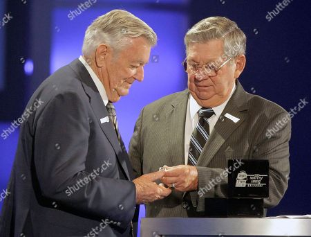 Bobby Allison, Donnie Allison Bobby Allison, left, is given his ring by brother Donnie Allison, right, as he is inducted into the NASCAR Hall of Fame in Charlotte, N.C
