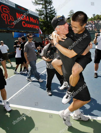 Daniel Nguyen, Steve Johnson Southern California tennis player Daniel Nguyen, right, is hugged by head coach Steve Johnson, bottom after defeating Virginia's Sanam Singh 7-5, 0-6, 6-3 to clinch the finals of the NCAA men's college tennis championships in Stanford, Calif., . USC defeated Virginia 4-3