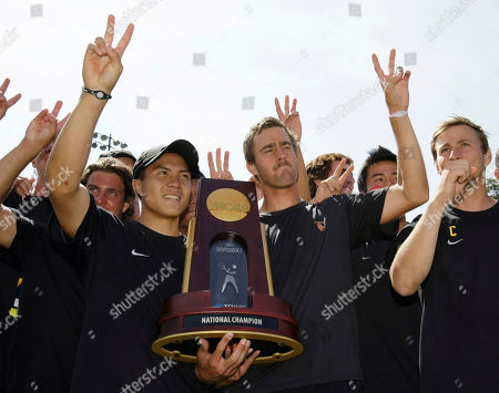 Daniel Nguyen, Steve Johnson Southern California tennis players Daniel Nguyen, left, and Steve Johnson, right, celebrate with the NCAA trophy after defeating Virginia during the finals of the NCAA college tennis championships in Stanford, Calif., . USC defeated Virginia 4-3