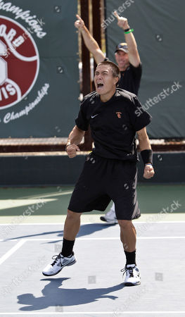 Daniel Nguyen, Steve Johnson Southern California's Daniel Nguyen celebrates, foreground, with coach Steve Johnson, background, after defeating Virginia's Sanam Singh 7-5, 0-6, 6-3 to clinch the finals of the NCAA men's team tennis championships in Stanford, Calif., . USC defeated Virginia 4-3