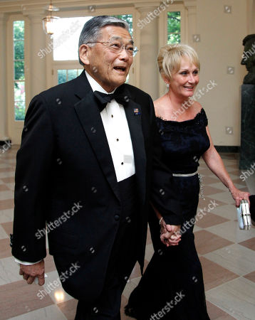 Norman Mineta, Deni Mineta Former Transportation Secretary Norman Mineta, and his wife Deni arrive for a State Dinner at the White House in Washington. The surveillance of Muslims by the New York Police Department, detailed in a series of recent stories by The Associated Press, brought back memories for him when at age 11 he and his family were interned during World War II