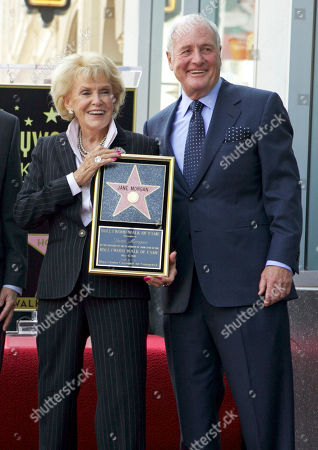 """Leron Gubler Jane Morgan, Jerry Weintraub Producer Jerry Weintraub, right, helps unveil a star for singer Jane Morgan, as she is honored on the Hollywood Walk of Fame in Los Angeles. Weintraub, the dynamic producer and manager who pushed the career of John Denver and produced such hit movies as """"Nashville"""" and """"Ocean's Eleven,"""" died, of cardiac arrest in Santa Barbara, Calif. He was 77"""