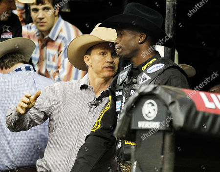 Chad Ochocinco, Ty Murray Former bull riding champion Ty Murray talks with Cincinnati Bengal receiver Chad Ochocinco before Ochocinco attempted to ride a bull named Deja Blu during the Professional Bull Riders' Lucas Oil Invitation bull riding event in Duluth, Ga