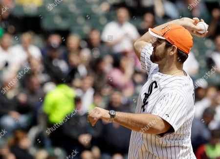 Gabe Carimi The Chicago Bears first-round draft choice, offensive tackle Gabe Carimi of Wisconsin, throws a first pitch before the Baltimore Orioles play baseball game against the Chicago White Sox in Chicago on