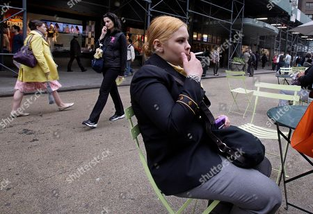 Amanda Perez Amanda Perez, of The Bronx, N.Y., smokes a cigarette in New York's Herald Square, . Starting Monday, a new law went into effect banning smoking in New York City's urban parks and other public places. The law will be enforced with a $50 fine per violation