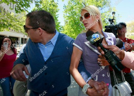 Cy Waits, Paris Hilton Cy Waits, boyfriend of Paris Hilton, left, reacts as he is grabbed by an assailant while walking towards court with Paris Hilton, right, in Los Angeles. The unidentified man was restrained by Hilton's bodyguards and detained