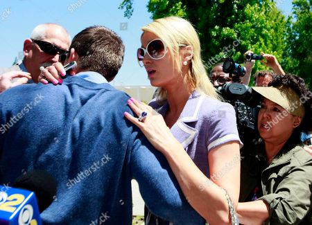 Cy Waits, Paris Hilton Paris Hilton, center, reacts as she comforts her boyfriend Cy Waits, left after Waits was grabbed by an unknown assailant as he and Hilton were walking into court in Los Angeles