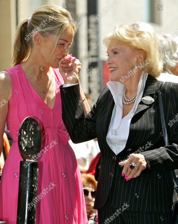 """Sharon Stone, Jane Morgan Actress Sharon Stone, left, kisses singer Jane Morgan's hand, as Morgan is honored with a star on the Hollywood Walk of Fame in Los Angeles Friday, May, 6, 2011. Morgan had six gold records and was a frequent guest on """"The Ed Sullivan Show"""