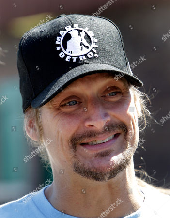 Kid Rock Recording artist Kid Rock smiles during a news conference on Belle Isle in Detroit, announcing he'll be playing a hometown concert at Detroit's baseball park this summer. Rock, Detroit Red Wings captain Nicklas Lidstrom and retired Red Wings defenseman Chris Chelios used paddle boards to cross the Detroit River to Belle Isle to make the announcement