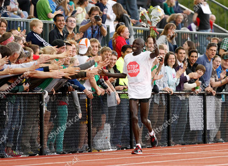 Moses Mosop Moses Mosop, from Kenya, takes his victory lap after winning the 30,000 meters race during the Prefontaine Classic track and field meet in Eugene, Ore., Friday, June, 3, 2011. Mosop broke the world record with a time of one hour, 26 minutes and 47.4 seconds