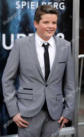"""Riley Griffiths Riley Griffiths, a cast member in the film """"Super 8,"""" poses at the premiere of the film in Los Angeles"""