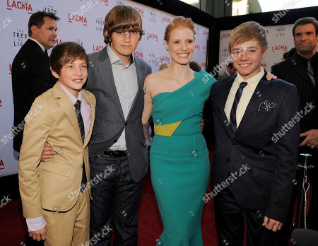 """Stock Image of Jessica Chastain, Hunter McCracken, Laramie Eppler, Tye Sheridan Jessica Chastain, second from right, a cast member in """"The Tree of Life,"""" poses with fellow cast members, from left, Hunter McCracken, Tye Sheridan and Laramie Eppler at a screening of the film, in Los Angeles"""