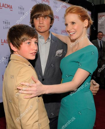 """Jessica Chastain, Tye Sheridan, Hunter McCracken Jessica Chastain, right, a cast member in """"The Tree of Life,"""" mingles with fellow cast members Hunter McCracken, left, and Tye Sheridan at a screening of the film, in Los Angeles"""