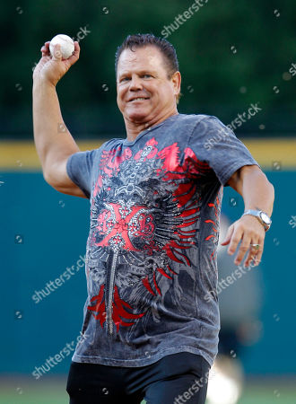 """Jerry """"The King"""" Lawler WWE wrestling star Jerry """"The King"""" Lawler throws out the ceremonial first pitch before a baseball game between the Cleveland Indians and the Texas Rangers, in Cleveland"""
